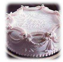 1989年GATEAUX 5月号掲載〈プロンケーキ〉[製作:門林泰夫氏] 自由が丘に伝わる門林彌太郎氏のレシピを元に再現したプロンケーキ。果物がぎっしり詰まったバターケーキを焼いてアプリコット・ジャムを塗り、パート・ダマンドを被せ、グラス・ロワイヤルで仕上げる。1年以上経過しても風味を保つ。